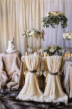 #floralchandelier #bride and #groom chairs #fur winter wedding