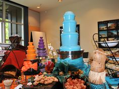 Randy Peters Catering Orange, Purple and Blue Chocolate Fountains