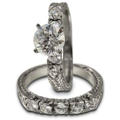Two Piece Antique Fishtail Engagement Ring Mounting -  This two piece wedding set has a total of 1.00ct of bright white diamonds. The engagement ring can accommodate a center diamond of any shape and size.    This exquisite matching pair of rings is reminiscent of the antique style. It is made of solid 14K white gold. The shoulders of the ring are squared off, and each ring has diamonds set in a modified fishtail mounting, under which there is openwork. The sides are incised with vintage...