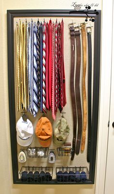 Inside of armoire closet doors for boys and on wall of Aarons closet  ...except I would put the hats above the ties and instead of trim deliniating the space, placing all the hooks on a board and hanging the board on the wall.  That way it wouldn't look odd for the belts to hang below the board.
