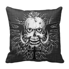 Skull With Rose, Horns, Cross, Wings Illustration Throw Pillow. Graphic Illustration of a black/white/grey skull with a rose poking through one of the bullet holes on his head. With big horns and black wings at the back of his head, propped by a black goth cross and black and gray dead tree branches as a background backdrop. See them all here: http://www.zazzle.com/ironydesigns/pillows?rf=238222968750191371&tc=pinterest