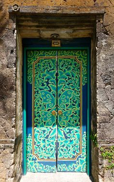 Bali, Indonesia. Stunning colours. Love the pristine painted door next to the rough stone walls.