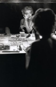 Hair & Beauty / Marilyn photographed applying her make up by Sam Shaw in September 1954. on Boxnutt