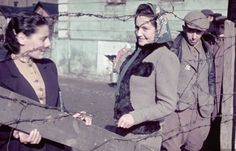Jewish women behind barbed wire in the Jewish ghetto of Kutno. Photograph by Hugo Jaeger. Kutno, Poland, October 1939.
