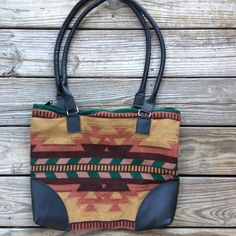 """Vegan Leather Aztec Kilim Ethnic Tote Bag 14"""" tall and 17"""" wide with double 33"""" handles. Vegan leather and woven body. Super roomy inside with covered plastic zipper. Net like lining. New without tags. Bags Totes"""