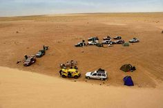 Modernday nomads from the 2006 Plymouth-Banjul Rally set up camp in the lee of a huge dune in the Mauritanian Sahara. Plymouth, Dune, Rally, Charity, Camping, Wheels, Adventure, Campsite, Outdoor Camping