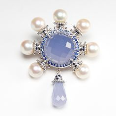 nautical brooch with chalcedony gemstone, some sapphires and pearls by Rina Limor
