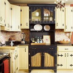 Create a Focal Point.  This piece was cleverly created by cutting French-style openings in the cabinet doors, adding furniture-style feet to the base of the cabinet, and crowning the top with molding. A shelving unit completes the illusion