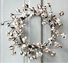 A beautiful cotton ball wreath made out of cotton balls and twigs, making it…