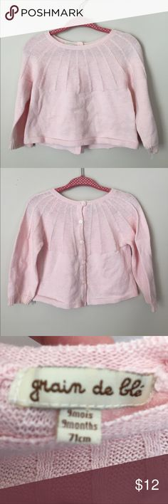 Grain de Blé Pink Toddler Girls Sweater Grain de Blé Pink Toddler Girls Sweater. Beautiful sweater purchased in France. Baby pink, long sleeves, buttons fully up the back. Good used condition, minor stains on sleeves - probably could come out with an extra good wash.   ⭐️ Bundle & Saved, No Trades ⭐️ Posh Compliant, Posh Rules Only ⭐️ All Offers Accepted or Countered ⭐️ Smoke & Pet Free Environment Grain de Blé Shirts & Tops Sweaters