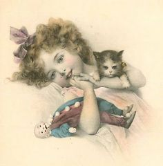 Vintage picture of a little girl holding her kitty and a doll.  Sweet.