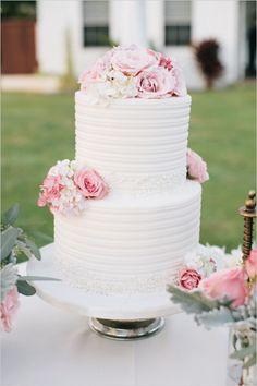 pink and white elegant wedding cake #weddingcake #elegantcake #weddingchicks http://www.weddingchicks.com/2014/03/05/hawaiian-pink-and-gold-wedding/