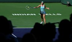 Maria Sharapova - BNP Paribas Open: Day 8.  Maria Sharapova of Russia hits a return to Camila Giorgi of Italy during the BNP Paribas Open at Indian Wells Tennis Garden on March 9, 2014 in Indian Wells, California. Giorgi won 6-3, 4-6, 7-5. (Photo by Stephen Dunn/Getty Images).