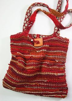 4-5 old t-shirts cut into strips and knitted into a bag!  brilliant!