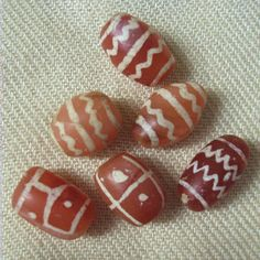 Six Ancient Etched Carnelian Beads.  Indus Valley, 400 BC to 400 AD.  Beautiful color with finely etched designs.  In very good condition; a...