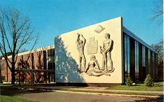 Library, Fairleigh Dickinson University, Teaneck, New Jersey - Frieze depicting the high sun of life and learning showing the Hackensack's shore supporting an Indian past, a bountiful Mother Earth, and a worker proud that his child reaches eagerly out to the future offered by Fairleigh Dickinson University.