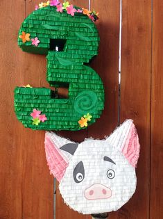 This Te Fiti / Moana Inspired Piñata is the perfect detail for your Moana Themed Party! **CAN BE MADE IN ANY NUMBER 1 - 9** *Piñata measures 24 high *Holds approximately 4-5 pounds of candy *Sturdy enough for multiple guest to participate *Easy to fill opening on top