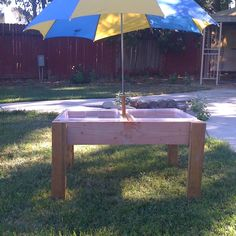 Homemade water/sand table w/ umbrella holder. Made out of plastic bins so they have covers! Thanks husband.