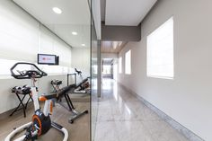 Ample Windows Connected To Gym Area Among Mount TV