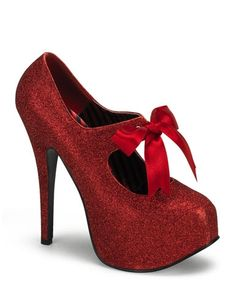 Mini glitter stilettos with a 5.75 heel, concealed platform, upper cut-out, and bow accent. $63.95.