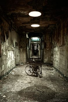 "https://flic.kr/p/9mSgPA | Wheelchair in asylum D | Thanks to Rusty who found this nice example of old wheelchair in this magic old lunatic asylum. The place closed down in the late 1990s, at a age of 150.  From the ""1000 miles and running"" tour. 10 urbex locations all around UK in 4 days.   Picture used by the band Chain Reaction on the cover of Revolving Floor album. <a href=""http://chainreactionpl.bandcamp.com/album/revolving-floor"" ..."
