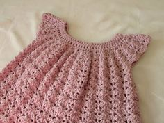 How to crochet a little girls shell stitch dress. This step by step tutorial will show you how to crochet a pretty, shell stitch girls dress top smock tunic. This project is suitable for beginners. How to make this dress in baby and toddler Crochet Dress Girl, Crochet Baby Cardigan, Baby Girl Crochet, Crochet Baby Clothes, Crochet Lace, Crochet For Kids, Crochet Dresses, Crochet Summer, Crochet Toddler Dress