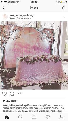 This beautiful sweetheart table is covered in blossoms and set in front of a pink tinted orchard photo and spring branches. Wedding Reception Decorations, Wedding Table, Wedding Ceremony, Reception Table, Trendy Wedding, Dream Wedding, Deco Rose, Lighted Branches, Cherry Blossom Wedding