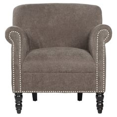 Showcasing nailhead trim and spindle wood legs, this lovely arm chair is perfect for accenting a plush shag rug in the den or creating a cozy reading nook in...
