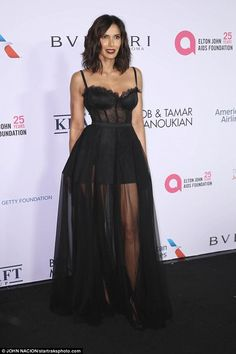Underwear as outerwear: Padma Lakshmi wore a black outfit that paired a bustier top with a mini skirt and long sheer overlay for a gala in NYC Tuesday night Bustier Top Outfits, Bustier Dress, Chris Evans, Black Bustier Top, Padma Lakshmi, Night Outfits, Beautiful Gowns, The Dress, Strapless Dress Formal
