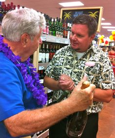 Sarasota Sister Cities President Tom Halbert discusses Treviso Province Prosecco selections from the Conegliano region in Italy with a wine manager at the newly opened Trader Joe's in Sarasota on September 7, 2012. The Conegliano Poggio delle Robinie extra dry prosecco and the brut Millesimato Conegliano Valdobbiadena prosecco superior are in the sparkling wine area. Treviso Province, Italy was twinned with Sarasota in 2007