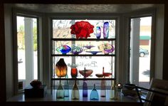 Beautiful and unique glass objects decorate the window in the art gallery section of Juma Gallery. (Allison Carey/The Plain Dealer) Cleveland Art, Shaker Heights, Cafe Menu, Art Gallery, Objects, Windows, Unique, Glass, Beautiful
