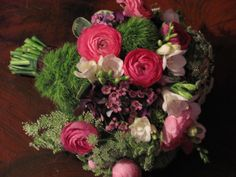 Hot colors, green dianthus, deep pink ranunculus, queen anna lace, freesia and pink wax flower