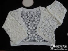 Nice classic white bolero. I think this would be fun in green with the little flowers in another colour.