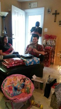 Cris opening his gifts tristy