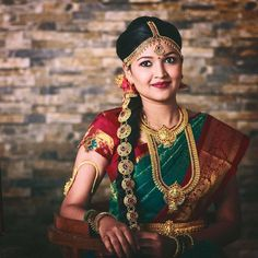 South Indian bride. Gold Indian bridal jewelry.Temple jewelry. Jhumkis. Forest green and red silk kanchipuram sari.Braid with fresh jasmine flowers. Tamil bride. Telugu bride. Kannada bride. Hindu bride. Malayalee bride.Kerala bride.South Indian wedding.