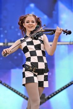 FILE - In this July 31, 2016 file photo, electronic violinist Lindsey Stirling performs at...