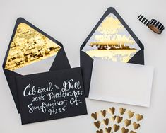 black envelope white calligraphy with DIY gold envelope liners