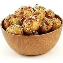 Rostad småpotatis i ugn med gräslök och honung