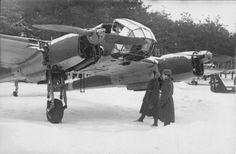 Soviet soldiers inspect a captured German spy plane Focke-Wulf Fw.189 'Rama'.