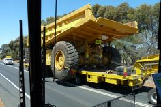 Large Dump Truck being transported to a Gold Mine