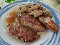 Grilled Iberian pork (presa ibérica) with wild mushrooms and apple sauce. La Alacena del Castillo, Puebla de Alcocer (Extremadura, Spain) http://www.piggytraveller.com/blog/2015/10/27/restaurant-la-alacena-del-castillo-puebla-de-alcocer/
