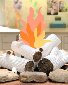 Cardboard Faux Logs... Or as I say, fake logs...  HAHAH!  Learn how to create an indoor fire for your kiddos! #camping #crafts