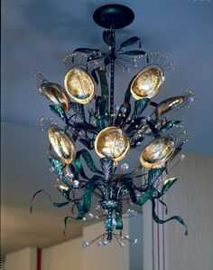 """Tony Duquette """"Abalone"""" chandelier, created for his one man exhibition at the Los Angeles County Museum of Art, 1952... now available through Baker Furniture."""