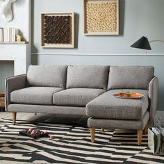 NEW! With flanged edges and slim wood legs, the Quinn Sectional marries modern form with clever functionality: Its detachable chaise switches easily from left to right, making room rearranging a breeze.