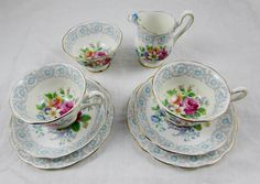 """Royal Albert """"Fragrance"""" Two Tea Cup and Saucer Trios with Matching Cream and Sugar Set"""