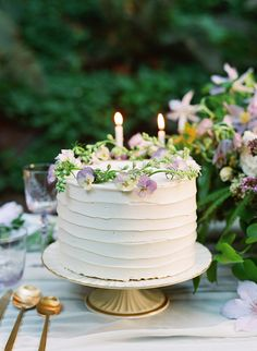 delicate white wedding cake with violet details