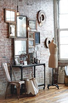 Boutique Vignette of Mirrors on Brick Wall