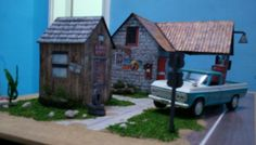 - == - - == - Vintage Service Station Paper Model - Assembled by Cebola - == - - == -   I do not know much about the modeler who made this beautiful assembly of the Vintage Service Station, all I know is that his name is Cebola. If I'm not mistaken, these pictures were originally posted on a forum about toy cars in  1/64 scale.  If you want to build your own Vintage Service Station paper model, the link to download is at the end of this post.
