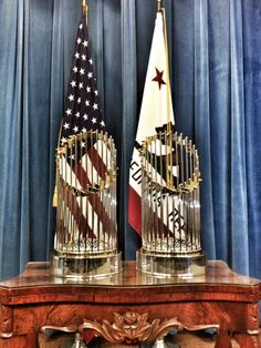 Awe, don't they look amazing!!! the 2012 SF Giants World Series Trophy ‏has its own Twitter account (@wstrophy) and this is one of the first pictures tweeted from the account.  It's a picture of the 2010 and 2012 World Series Trophies in the Office of the Governor in Sacramento, CA.