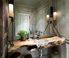 "A very unique bath. Lots of original ideas to be found including the iron chain supports and spalted wood ""top"""
